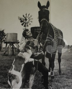 First female trainer of a horse in the Melbourne Cup: Betty Shepherd in Melbourne with Trevors and the guard dog Rastus.