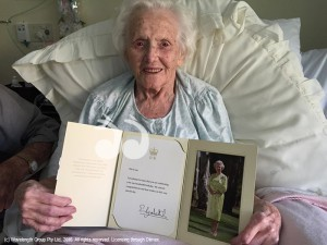 Mrs Cone holding a letter from Her Majesty Queen Elizabeth II