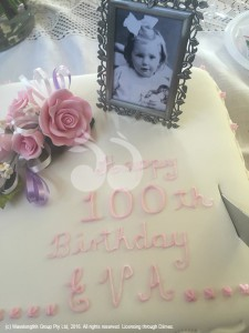 The birthday cake for Eva with picture of her as a child.