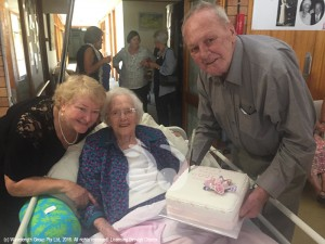 Eva with her daughter Elaine and son Donald celebrating her 100th birthday