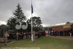 The last post being played as Val Quinell, president of the Scone RSL sub-branch raises the flag at the Scone ANZAC Day awn service.