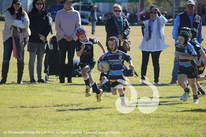 Henry Teague makes a break for the Under-8s against Moree.