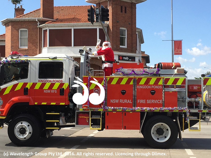 Santa is getting ready to climb on the fire truck and visit the children of Scone.