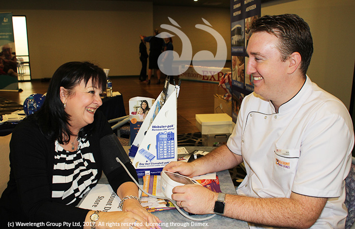 Dianne Pittard having her blood pressure taken by Ben Butters from Scone Discount Drug Store.