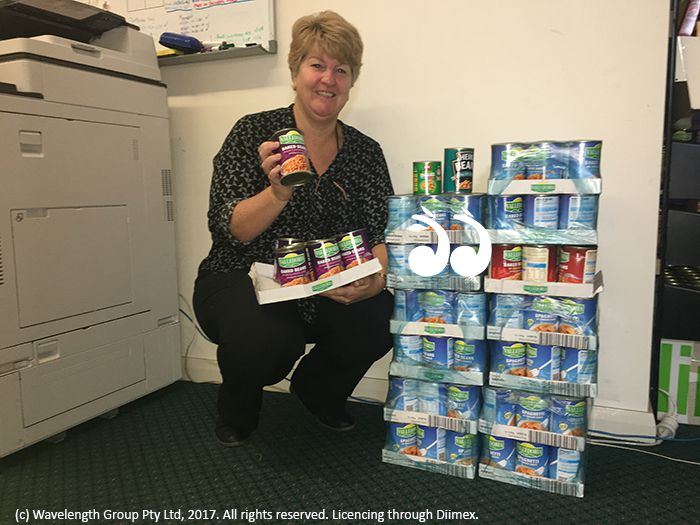 Lee Watts, manager of the Scone Neighbourhood Resource Centre withh a stack of baked beans which were donated this morning.
