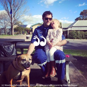 Mitchell Beaman with his dog Narla and his little girl Evie.