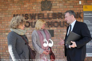 Cr Sue Abbott, Leah Marchant and John Preston discussing the personal violence order matter outside Muswellbrook Court House yesterday.