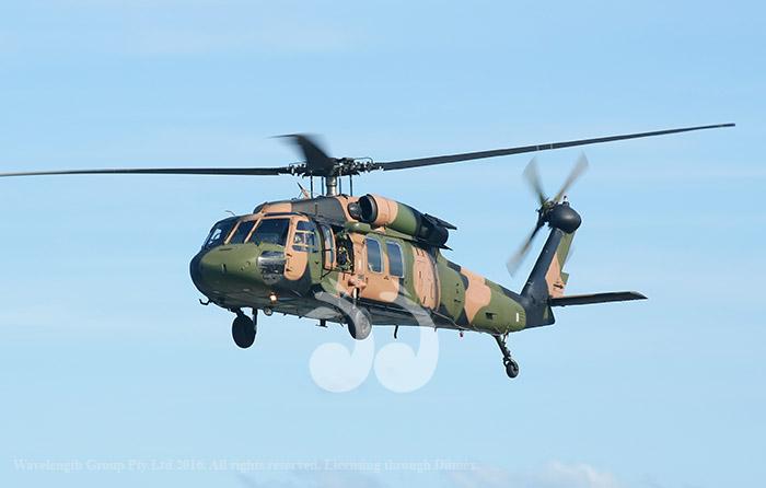Australian Army Blackhawk chopper flies by. Image from Adobe Stock