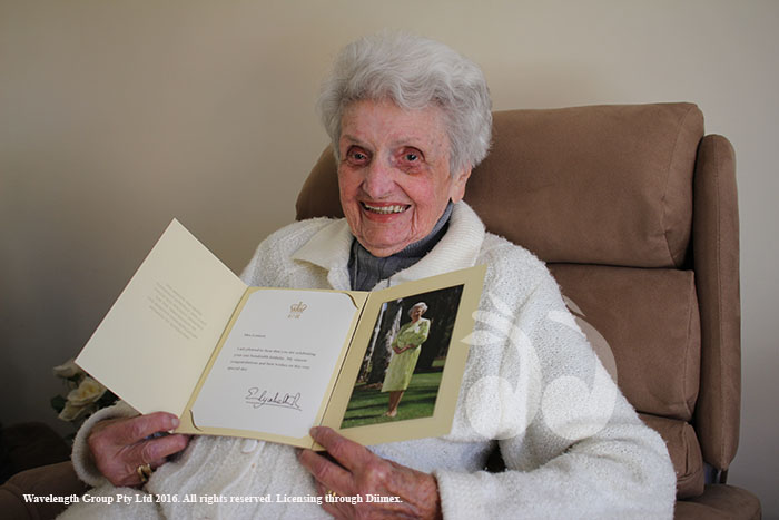 Alma Lennone holding her birthday well wishes from the Queen.