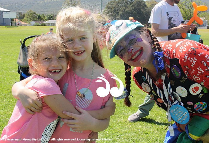 Zali Keats and Jemima Presland with Sparkles the Clown at last years family fun day.