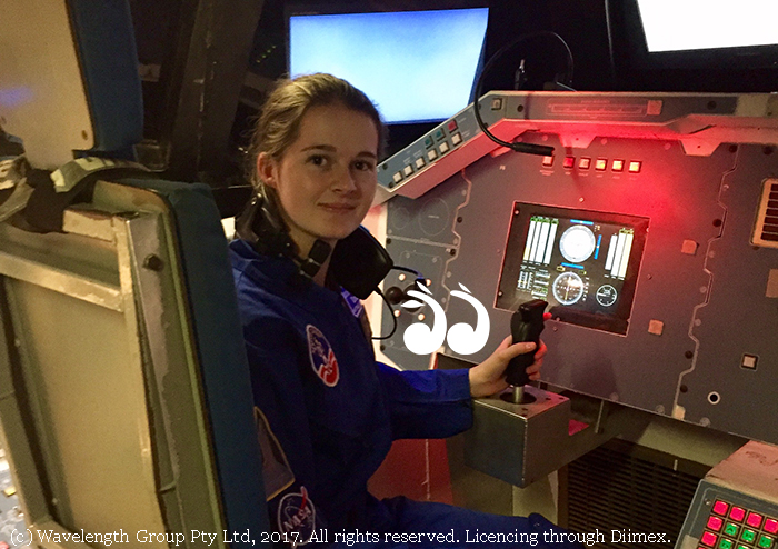 Izzy Roughan at the controls of a space shuttle simulator.