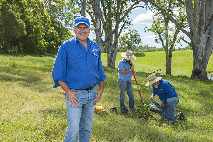 Rob Henderson from local land services planting trees.