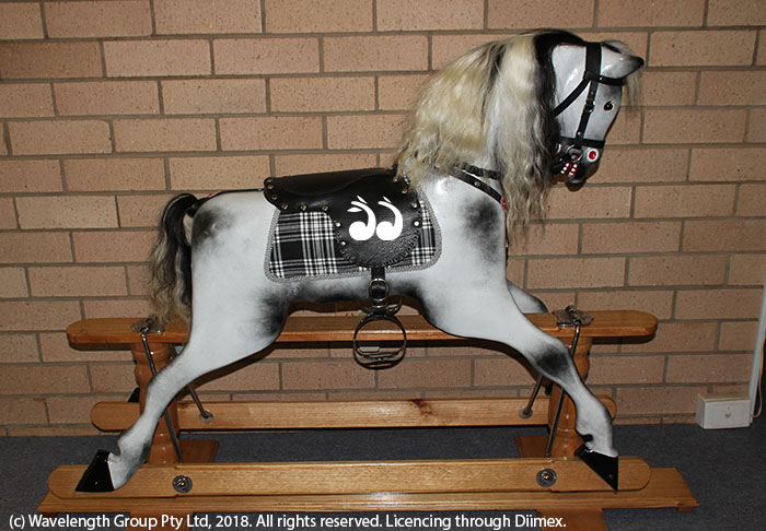 A restored rocking horse won by Lorraine Ray.