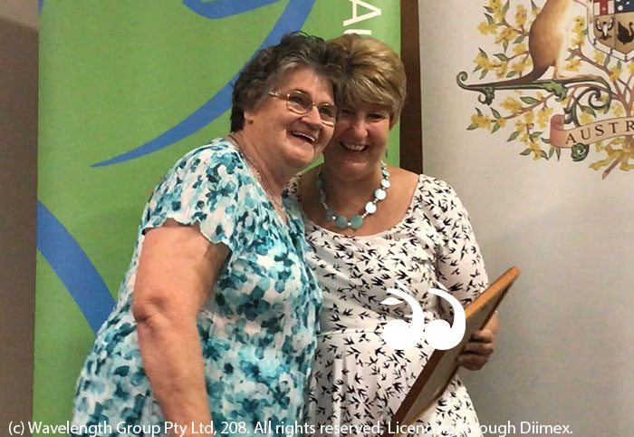 Scone's Citizen of the Year Lorraine Gardiner accepting her award from Cr Lee Watts.