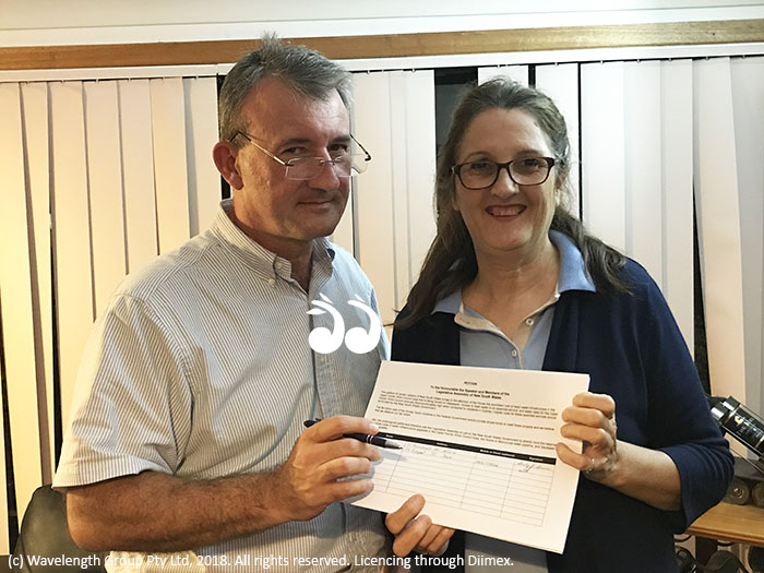 John Preston signing the water rates petition with Mary Jane Blake.