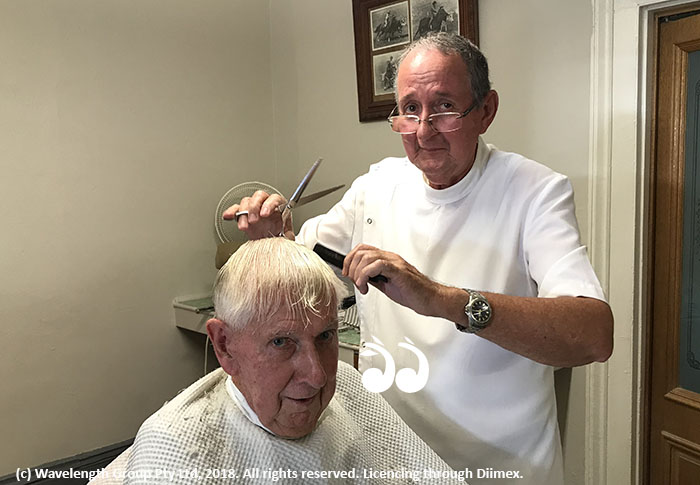 Chris Winter cutting his uncle's hair Fred Winter.