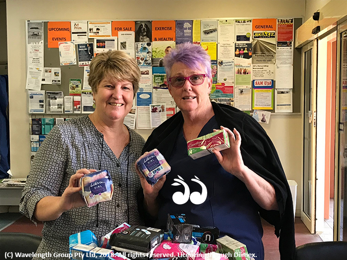 Lee Watts from the Scone Neighbourhood Resource Centre receiving a donation for Share the Dignity from Gaye McCauley, Scone Medical Practice.