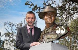 "Ross McMullin with a sculpture of Harold ""Pompie"" Elliott."